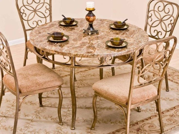 Classy round granite dining table design