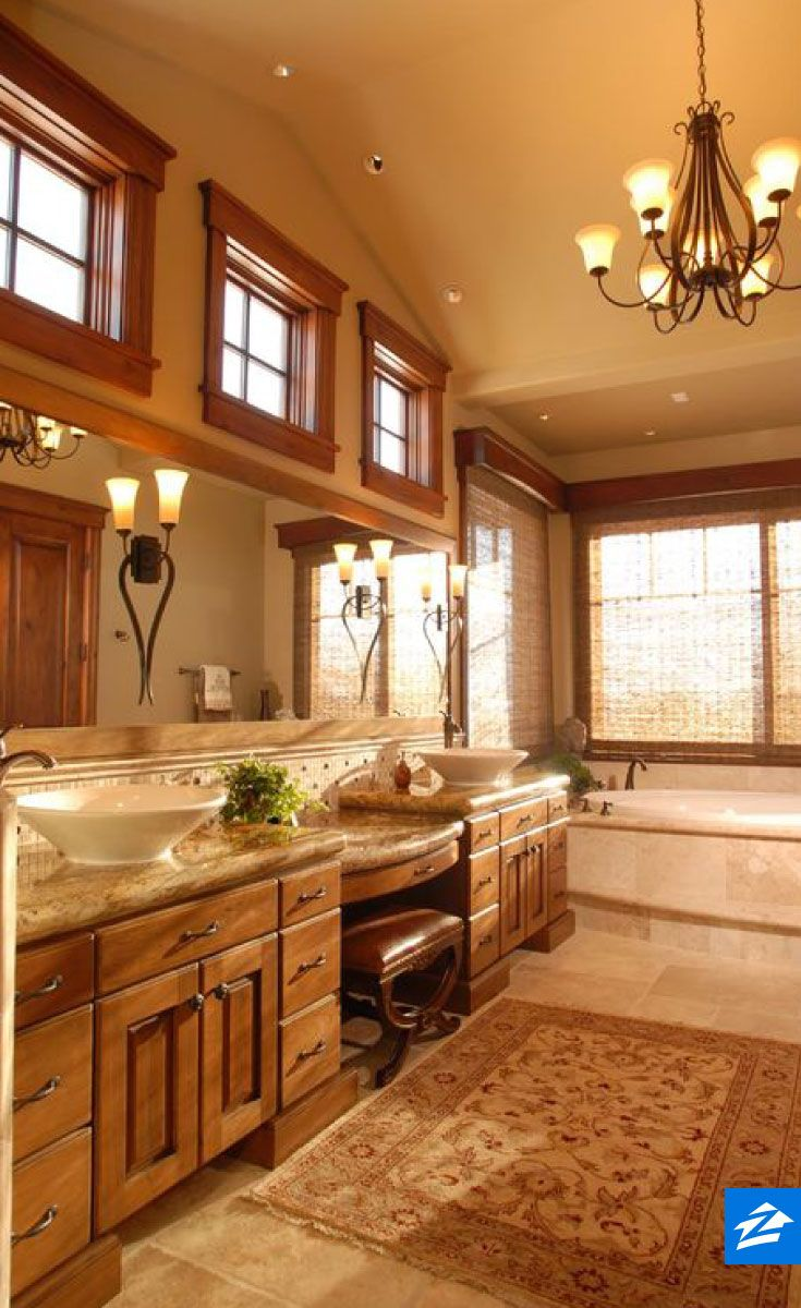 Bathtime is extra cozy in this craftsman space the wood for Rustic master bathroom designs