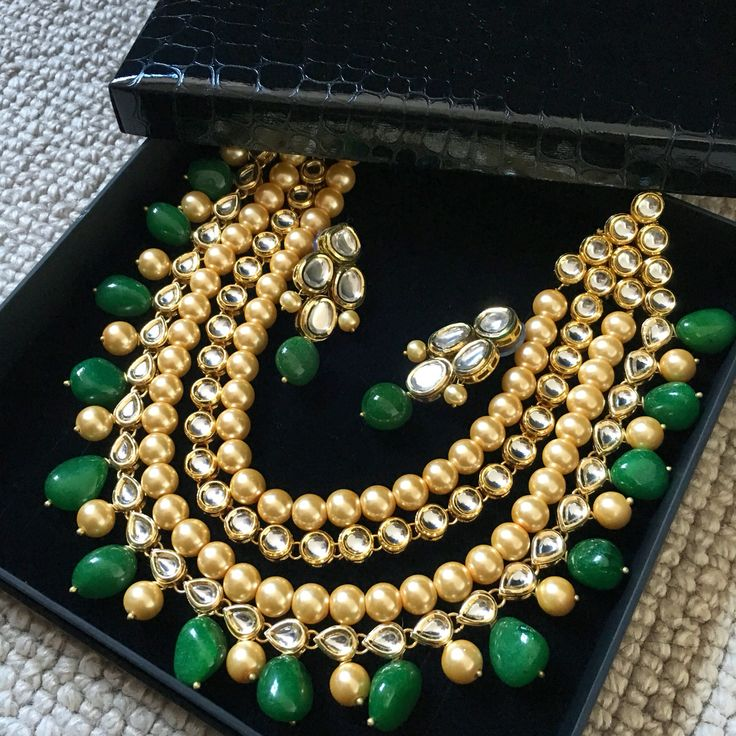 Emerald, oyster pearl and kundan necklace and earrings set. Indian jewellery that makes a statement!