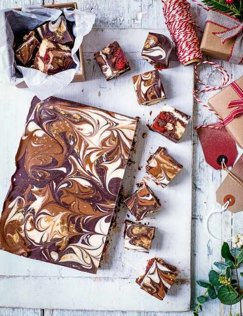 Baileys Chocolate Tiffin Recipe Check out these indulgent chocolate tiffins with our favourite Christmas drink in solid chocolate form. You don't have to include the edible glitter but it does give added bling