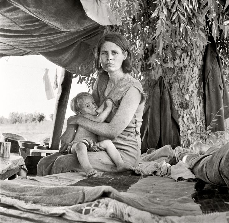 """August 17, 1936. Blythe, California. """"Drought refugees from Oklahoma camping by the roadside. They hope to work in the cotton fields. There are seven in family."""