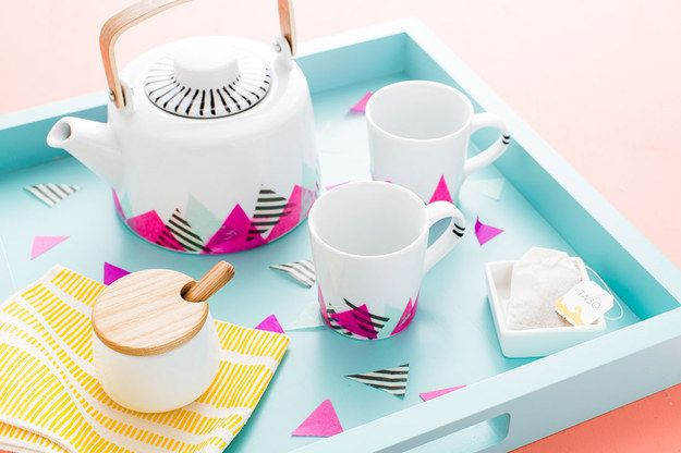 Make a ridiculously cute tea set with tissue paper, permanent marker, and Mod Podge.