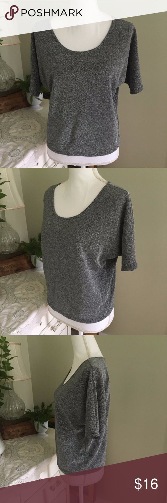 """Express Silver Short Sleeve Top This shiny, silver top from Express is slightly sheer and lightweight. Features short sleeves and scoop neck. Size: XS. Chest: 21.5"""". Length: 21"""". Express Tops"""