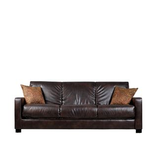 Leather couch with sofa bed. Versatile for an office that also needs to double as a guest room.