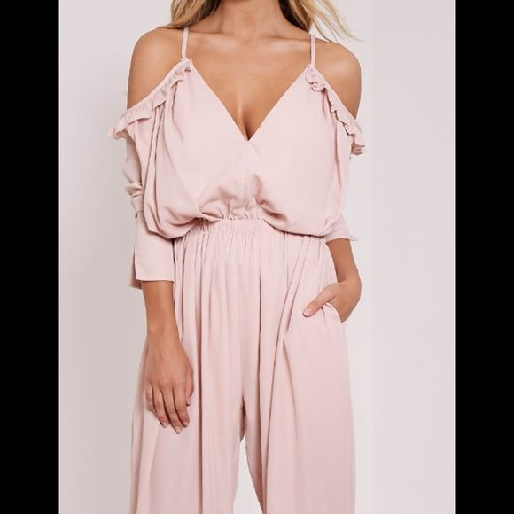 """Pretty Little Things pale pink/nude jumpsuit So adorable! TAGS STILL ON, Never worn. Pale pink/nude jumper. Best suited (in my opinion) for someone 5'6"""" or shorter if you plan to wear heals! I'm a bit too tall for it, that's why I'm selling! **size UK 8, fits like US 4 PrettyLittleThings Pants Jumpsuits & Rompers"""