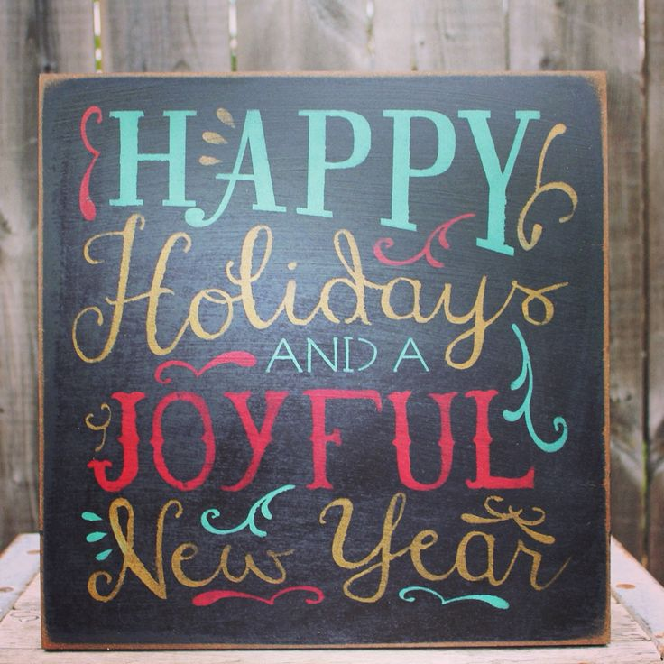 Happy Holidays and a Joyful New Year sign made by The Primitive Shed, St. Catharines