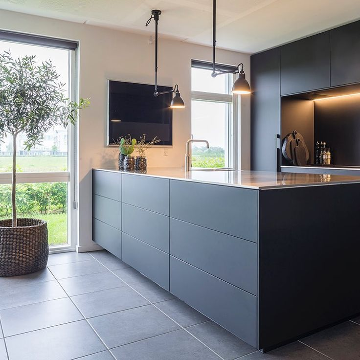 Fenix is an innovative material for interior design: an extremely matt, anti-fingerprint and very resistant surface for your kitchen. This kitchen was designed by Dorte Brandt, Multiform Herning.