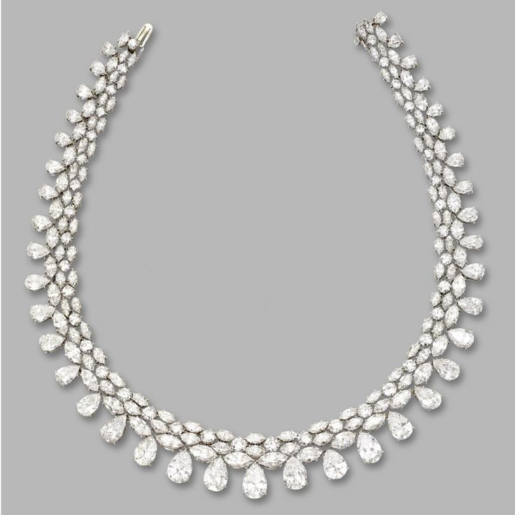 DIAMOND NECKLACE. Center pear-shaped diamonds weighing approximately 2.10, 2.30, 2.60, 2.20 and 1.80 carats, remaining pear-shaped, round and marquise-shaped diamonds weighing a total of approximately 73.45 carats, mounted in platinum, length 14½ inches.