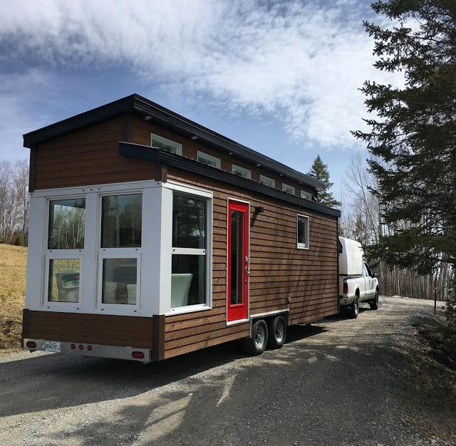 A beautiful, modern house on wheels from Vivre En Mini; a tiny home builder based in Alma, Quebec.