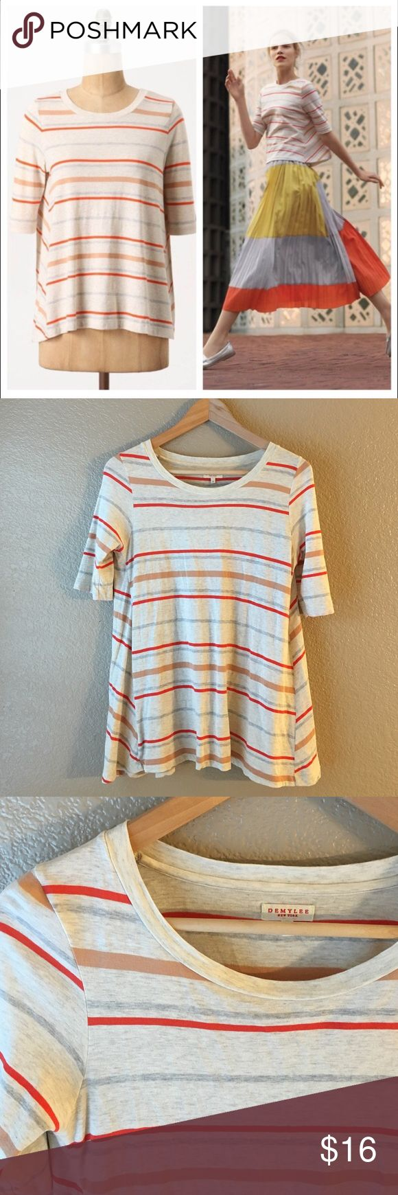 """Anthropologie Demylee Bobbi swing tee Anthropologie. Demylee brand. Size small. Bobbi pullover swing style tee. Creamy heather grey with beige, grey and red-orange stripes. Super soft, stretchable Pima cotton. Half sleeves, scoop neckline. Approx length 26"""", bust stretches up to 22"""" across, hips free. In excellent condition. The cutest swing tee for all seasons! Anthropologie Tops"""
