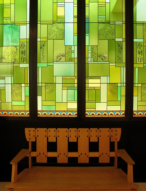"""Stained glass windows (1889) by Constant Montald from a house in the 'Koning Leopold II-laan"""" in Ghent, Belgium. The bench is from around 1905 and was designed by Gustave Serrurier-Bovy.    The Design museum Gent has one of the most superb Art Nouveau collections in the country. The exuberant period of Art Nouveau with its floral motifs and play of flowing lines and the more constructivist direction taken by the 1900 style are both shown in the museum."""
