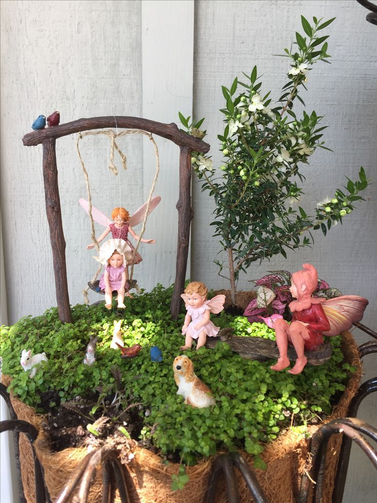 Miniature Fairy Garden - FAIRY SITTING is about two older fairies who are sitting two baby fairies. The fairy sitters are doing a great job by keeping the baby fairies entertained at the playground -- one on a swing and the other on the see saw. The dog and three rabbits seem to be quite relaxed. There are birds at the park, too. Everyone is enjoying the afternoon at the playground. 6/2015