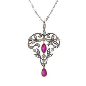 LOT:21 | An Edwardian silver and gold Burmese ruby and diamond pendant.