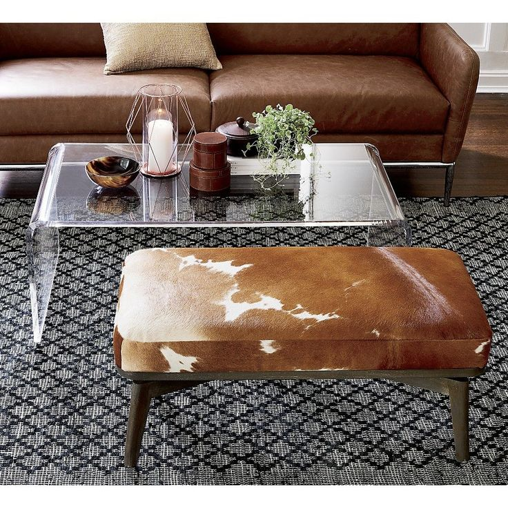 Shop royalton cowhide bench. Gorgeous caramel and white cowhide warms the seat of grey-stained bench designed by Jannis Ellenberger. Rustic seat provides welcoming perch in entryway, at the end of a bed, or as side/coffee table.
