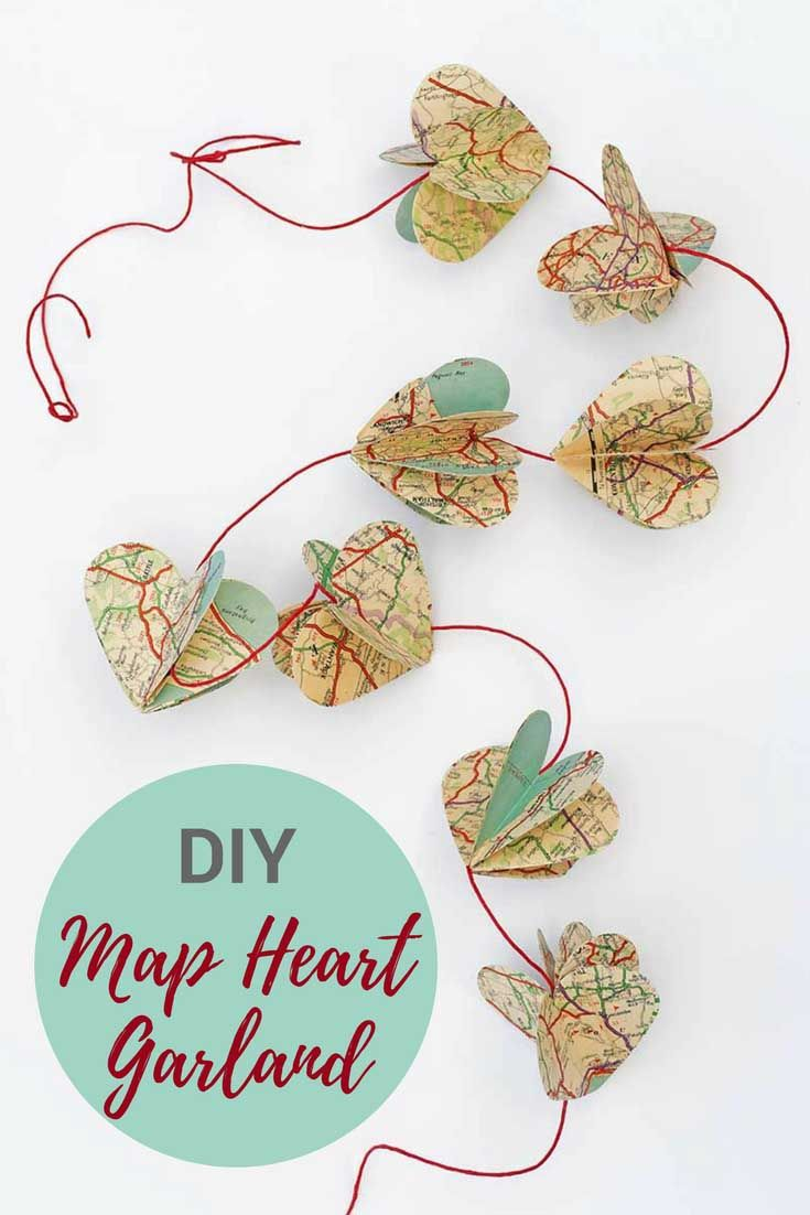Make a gorgeous DIY heart garland out of vintage road maps to decorate your home.  #mapheart #valentine's #valentinesday #heartgarland #valentine's decoration