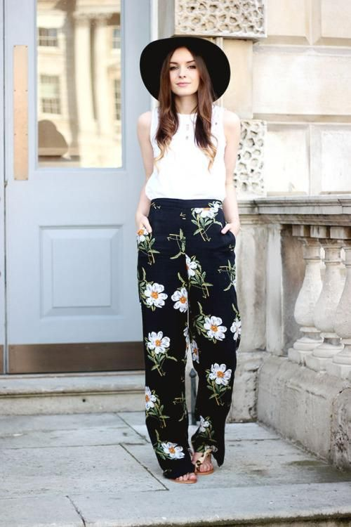 Patterned Pants: 20 Outfit Inspiration Photos - structured wide-brim hat + sleeveless white top, tucked into a stunning pair of boho chic floral wide leg pants