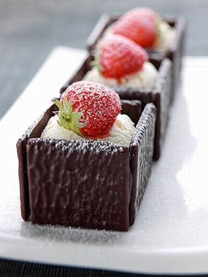 Mini desserts with chocolate biscuits and strawberry on top #sweetness #dessert