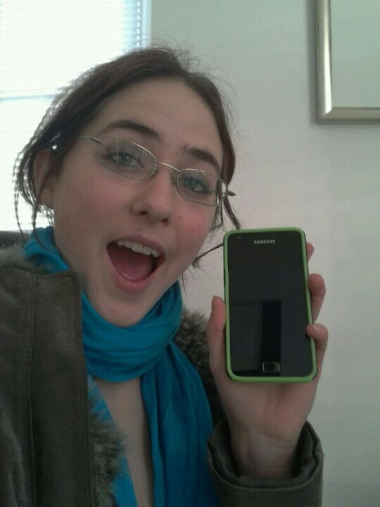 My sister Ronja proudly presenting her new phone