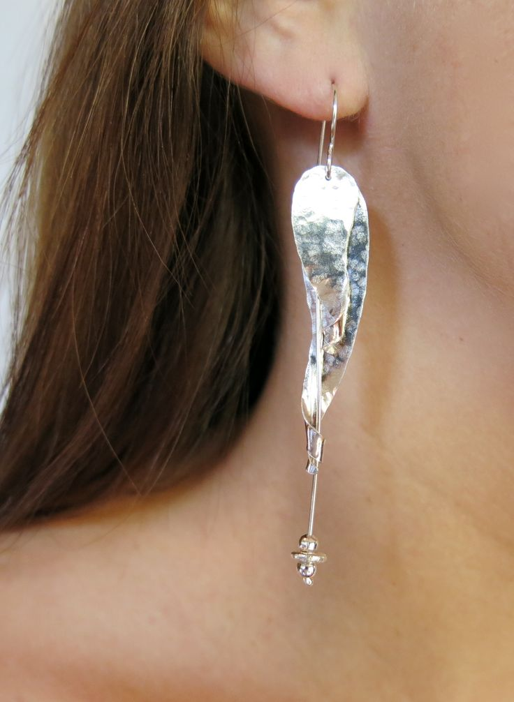 A pair of hand-formed sterling silver leaves curl around a single drop. These stunning  earrings move & catch the light beautifully! Just $100 (AUD) from www.mhoriginals.com.au ❤️