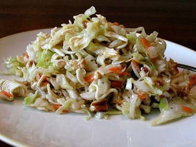 Ramen Noodle Slaw - 1 (16oz) pack of slaw mix, 2 (3oz) packs beef flavored Ramen, 1 cups sliced almonds, 1 cup sunflower kernels, 1 bunch gr. onions chopped.  Toss, then coat with mixture: 2 Ramen beef flavor packs, 1/2 cup sugar, 3/4 cups veg oil, 1/3 cup vinegar.  Cover and chill before serving.