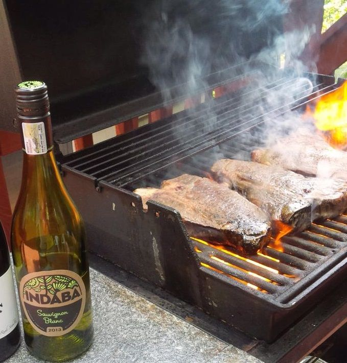Cooling off with Sauvignon Blanc while grilling up t-bones.