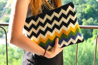 This is a fun and funky clutch. Perfect for carrying a few special items around… fits an i-pad, wallet, your crochet hooks perhaps? A zip closure keeps it all secure.