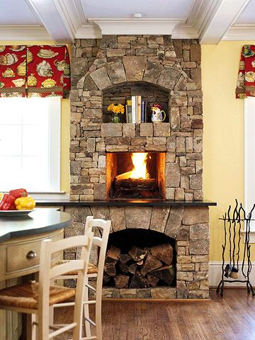 a fireplace in the kitchen or keeping room
