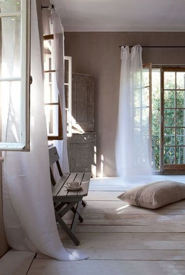 lots to like about this room, open airy feeling, love the doors & windows and of course the lovely soft curtains and beautiful wood floor. I like the window placement and flooring for a master bedroom