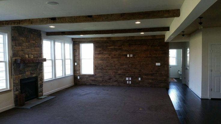 Reclaimed wood beams, mantle and shiplap paneling at its finest.