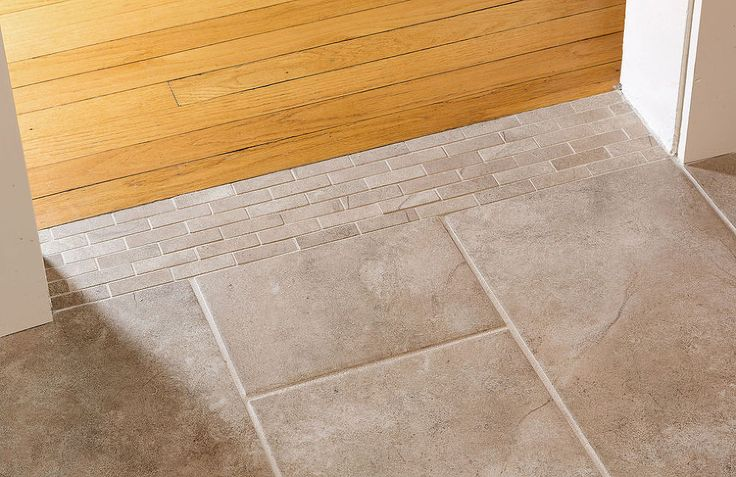 Timber up against grey tile