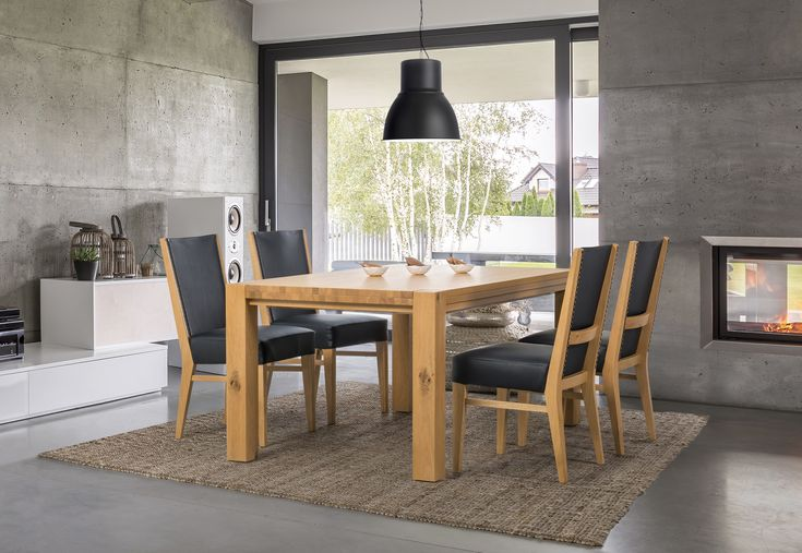 Solid wood table (FREIRAUM group) with comfy chairs from Klose. #KloseFurniture #moderndinignroom #woodentable