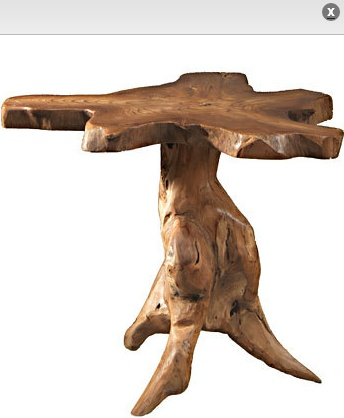 I love distinctive furniture.  This table has plenty of character.  It was made from the root of a teak tree.