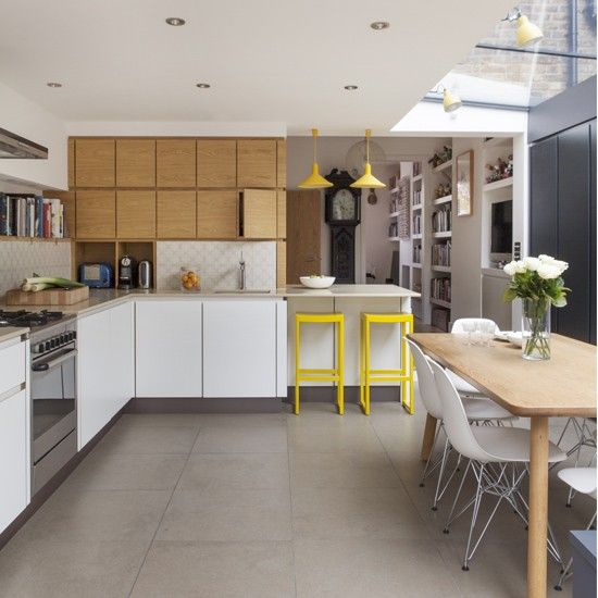 Smart kitchen-diner in toning neutrals with acid yellow touches