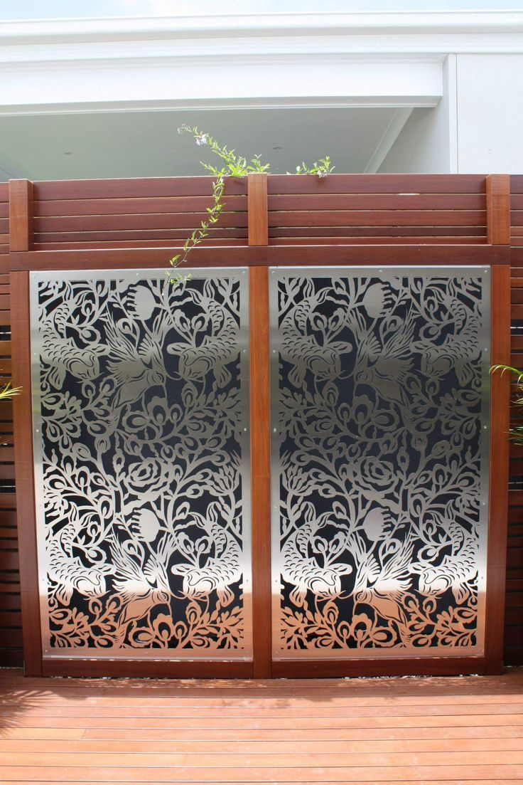 """URBAN METAL : Outdoor Decorative Screens.  Stainless Steel + Timber - a match made in heaven !  Stainless Steel panels were custom framed in timber , creating a stunning combination. Urban Metal . Decorative Screening. Privacy Screens. Light Feature.  Design : Urban Metal """"Freedom"""""""