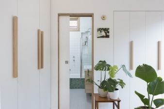 Wood handles contrast with the white cupboards