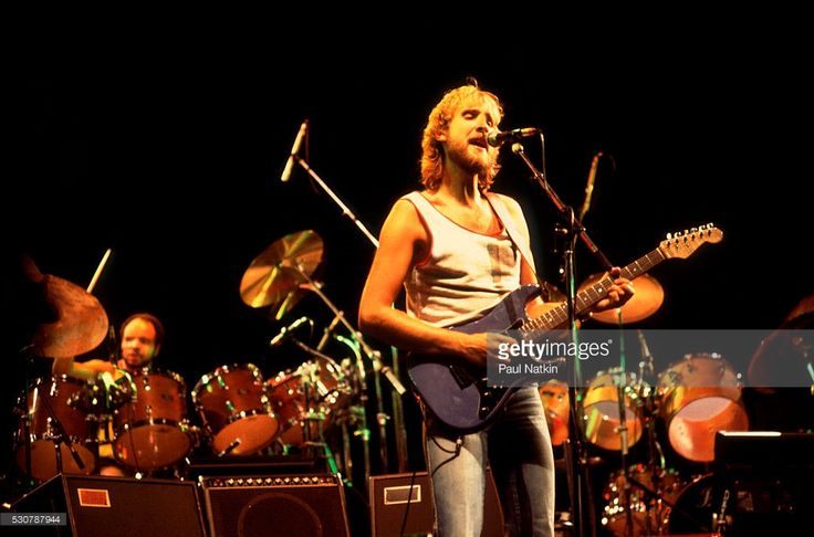 British Pop and Rock musician Mike Rutherford of the group Genesis performs onstage at the Poplar Creek Music Theater, Hoffman Estates, Illinois, October 2, 1982.