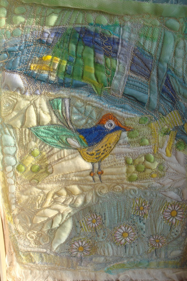 I embroidered this quite cute little bird on silk...but I am going to change it slightly...!