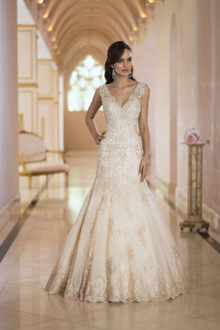 This is a brand new, never worn Stella York gown, style number 5922. It still has the original tags on it and has never been altered. It is a truly beautiful gown in a soft light gold color with beadi