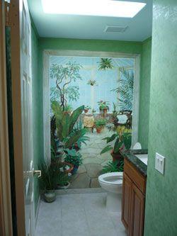 Small Bathroom Made Look Visually Bigger By A Hand Painted Wall Mural.