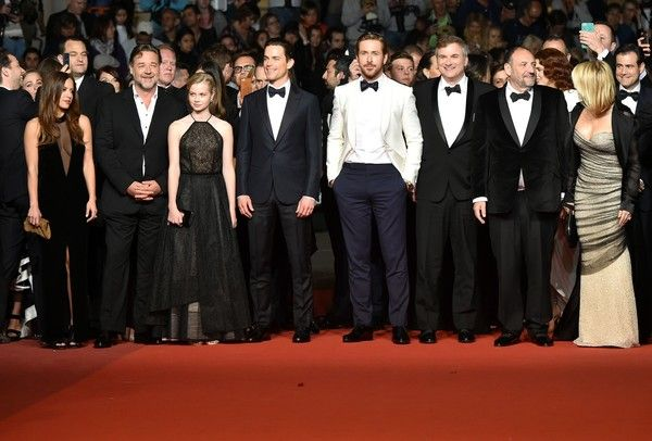 """Russell Crowe Photos - (FromL) US actress Murielle Telio, New Zealander actor Russell Crowe, Australian actress Angourie Rice, US actor Matt Bomer, Canadian actor Ryan Gosling, US director Shane Black, US producer Joel Silver and his wife US producer Karyn Fields pose as they arrive on May 15, 2016 for the screening of the film """"The Nice Guys"""" at the 69th Cannes Film Festival in Cannes, southern France.  / AFP / ALBERTO PIZZOLI - 'The Nice Guys' - Red Carpet Arrivals - The 69th Annual…"""