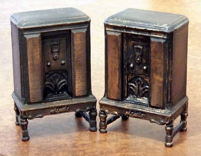 Pair of Vintage Cast Iron Majestic Radio Banks, Modeled After a 1930s Majestic Radio Console.
