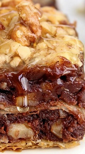 Brownie Baklava ~ Crunchy layers of phyllo dough filled with fudgy cinnamon-spiked walnut brownie and soaked in sweet honey to become brownie baklava bliss!
