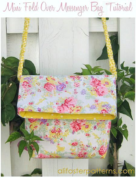 Mini fold over messenger bag tutorial by Ali Foster - very cute! Will be making this with cloth straps/lanyard and zippered pocket on back.