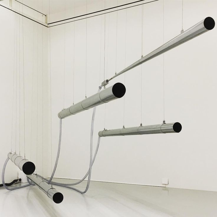 The suspended organ pipes of 'Meatus' (2017), by Das Numen, installed at the Sprengel Museum, Hannover, as part of Made in Germany. The project sees the Berlin-based collective (comprising Julian Charrière, Andreas Greiner, Markus Hoffmann and Felix Kiessling) collect real-time readings of wind velocity and direction from a number of weather stations around the globe, and then pass the results through a program that converts raw data into raw sound  #dasnumen #sprengelmuseum #hannover…