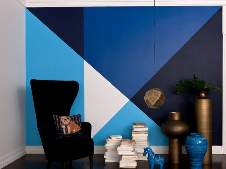 This intense geometric feature wall is rich and layered in textures, although striking at first the different hues of blue work together to create a calming relaxing atmosphere.