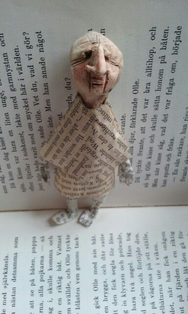 "Art doll ""Hiding behind the Words"" . Ceramics and book-pages. Book art"