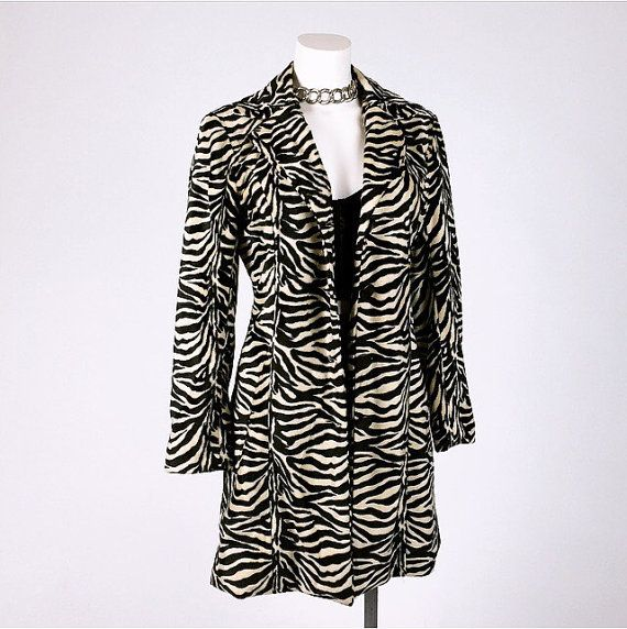 Vintage 90s zebra fur button coat. Fur is soft and stripey and in excellent condition. Fully lined, buttons up the front. Made in the USA
