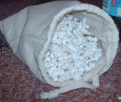 Popcorn - microwave in muslin bag - making microwave popcorn in paper bags works well, but it does waste bags. So, now, with the muslin bag, we'll avoid the nasty chemicals in the store bought, flavored popcorn AND conserve paper. It's a good day!