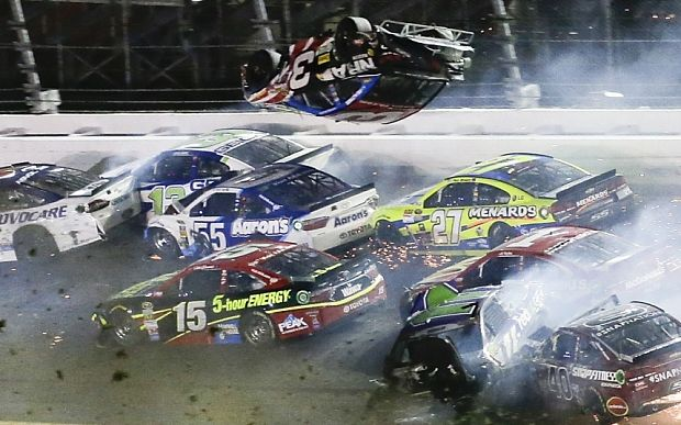 Video: Huge Nascar crash ends race with car flipping into fence but somehow…
