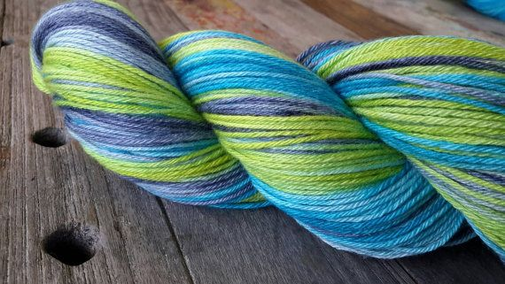 A beautiful soft squishy yarn in a lovely summery colourway, perfect for next to the skin projects such as shawls, scarves and socks. The silk content gives the yarn a beautiful sheen and softness.  - 4 to 5 ply yarn - fingering /sport weight - 50% Merino - 50% silk - 100g - approx 350m (382 yds) - suggested needle size 2.5mm (US 2) - 4MM (US 6) - Recommend hand washing in warm water with a gentle wool wash. Dry in the shade.  I hand dyed both available skenes at the same time, however p...